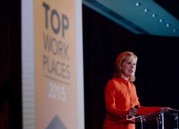 Ginger Hardage Accepting Top Work Place Award